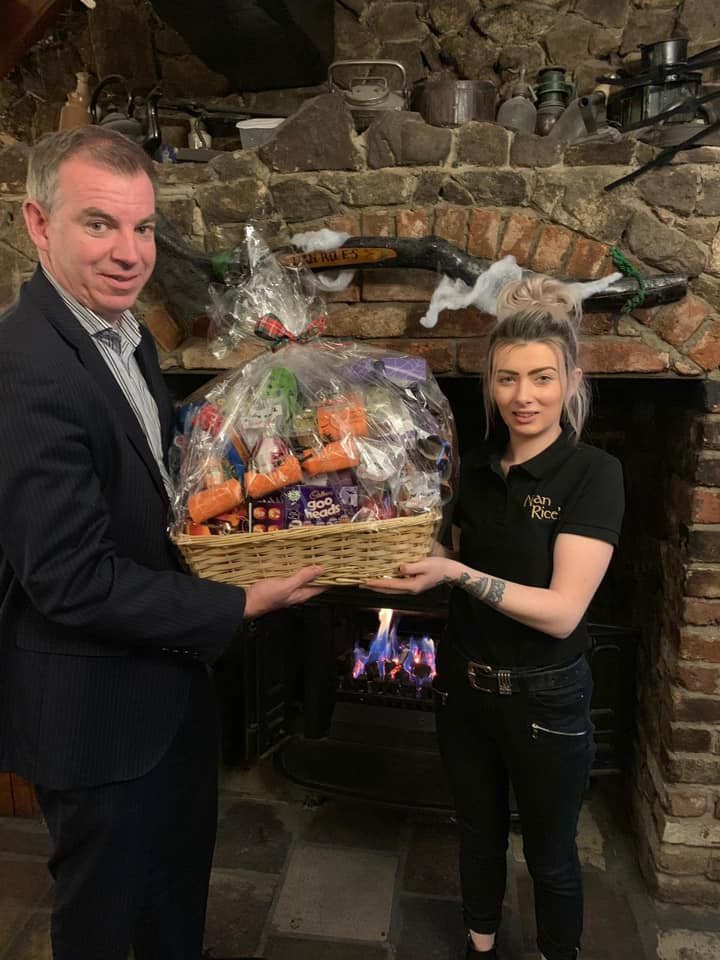 Cliodhna from Nan Rices Bar being presented with the Halloween prize Hamper from Newry BID manager, Eamonn Connolly.