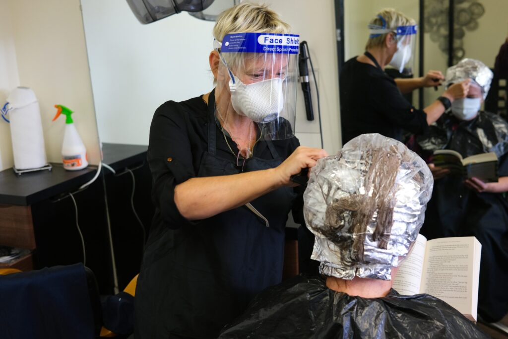 Back to work for Eileen Devine at Exclusive Hair Design with Jennifer Linnie in the seat. Photograph: Columba O'Hare/ Newry.ie